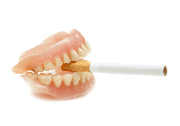 Dentures with a cigarette