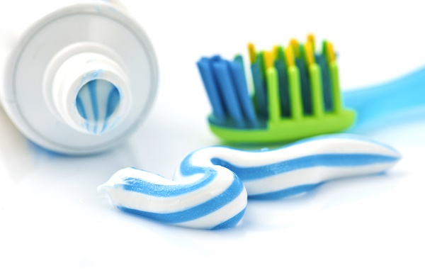 toothpaste with tube and toothbrush