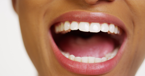 Close up of African woman with white teeth smiling