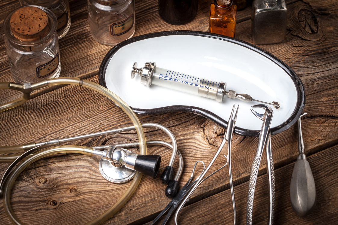 Retro medicalinstruments on a wooden table. Shallow depth of field.